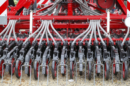 stock-photo-21196195-red-and-white-seeder-machine-in-close-up