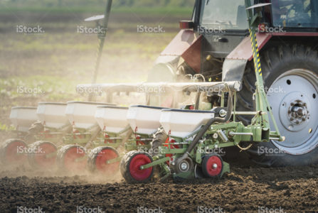 stock-photo-95608791-tractor-seeding-crops